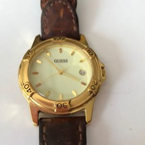 Guess watch in Gold w/brown woven leather band.